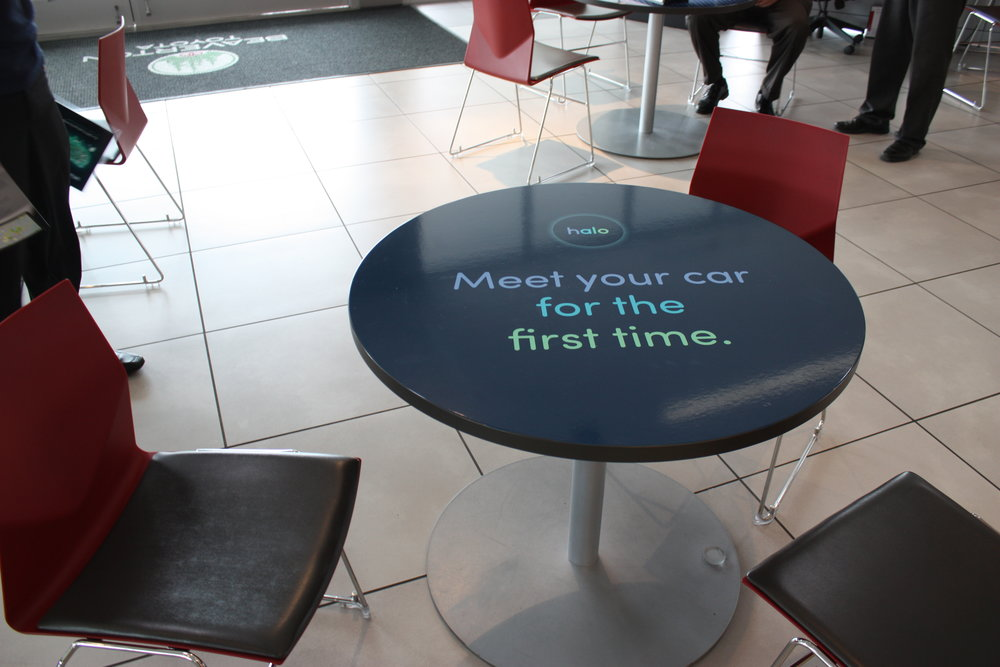 We covered every table in the dealership with branded vinyl