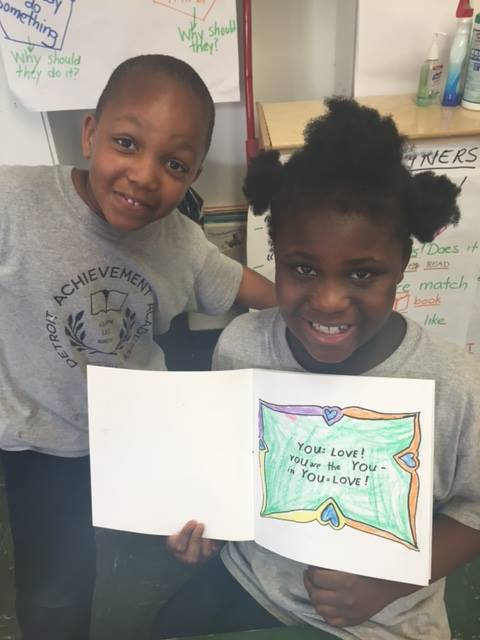 "Two beautiful faces from the Detroit Achievement Academy with the ""You=Love"" coloring book."