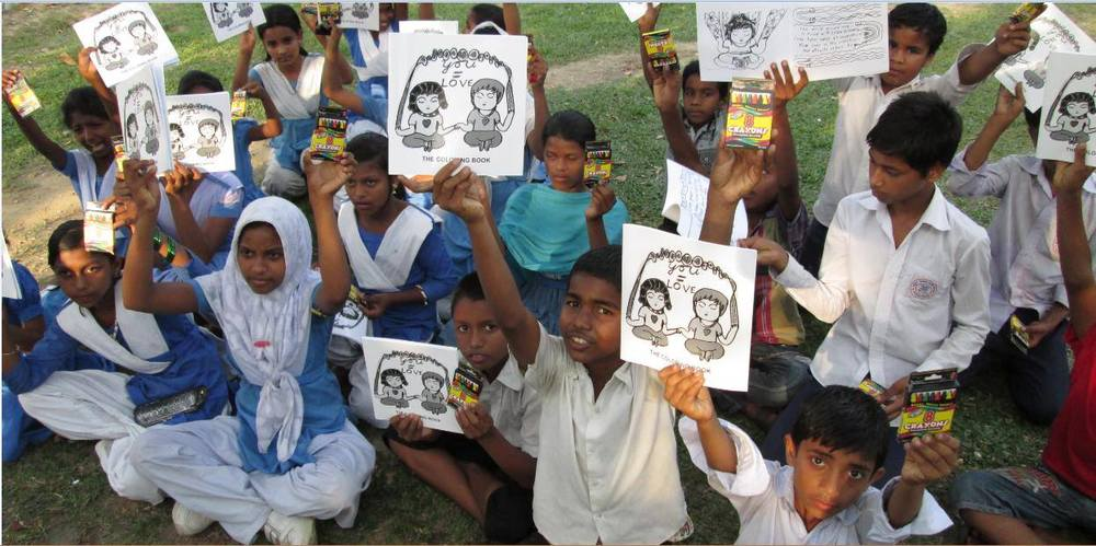 Kids in Dhaka, Bangladesh with their You=Love coloring books.