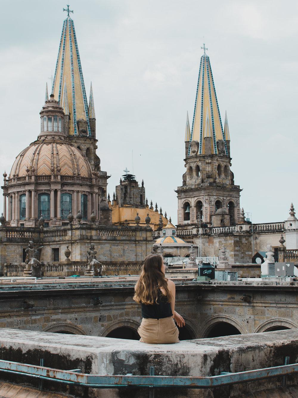 Sitting on the roof of Palacio de Gobierno in Guadalajara