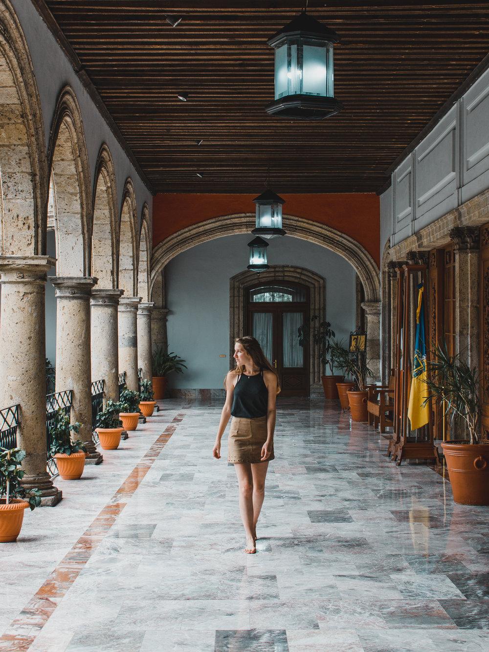 Strolling through the halls of Palacio de Gobierno in Guadalajara, Mexico