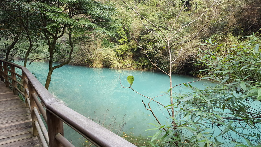 Turquoise water at the bottom of Zhangjiajie Grand Canyon