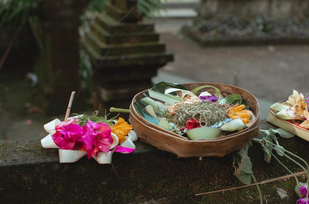 Hindu temple offering being prepared in Ubud