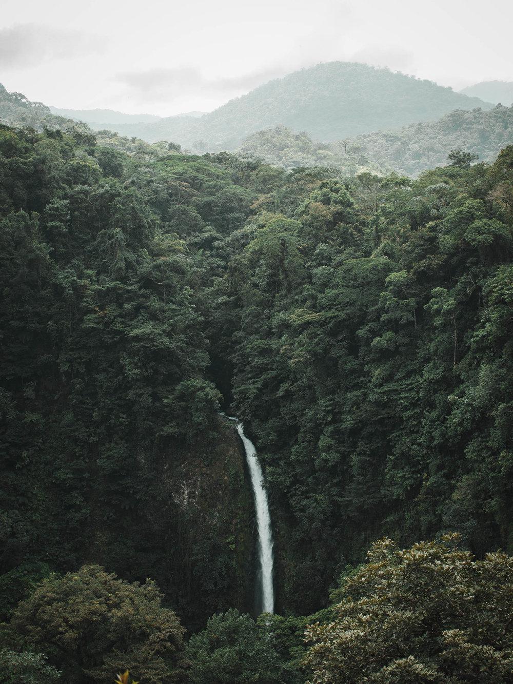 Swim at the bottom of La Fortuna Waterfall