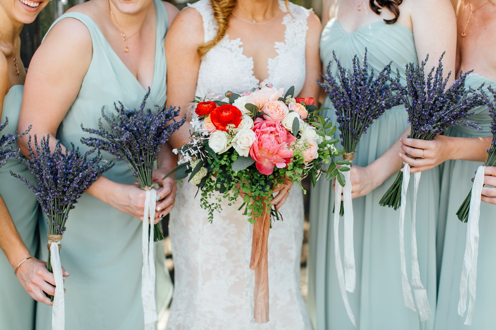 I loved the simple lavender bouquets for the bridesmaids and all the fun pops of color for Stephanie's bouquet. Eden Floral nailed it!