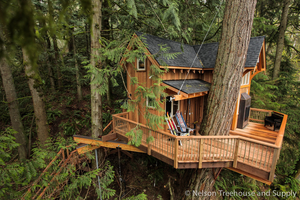 This ski chalet-themed treehouse was built in a sturdy Douglas fir and two red cedars