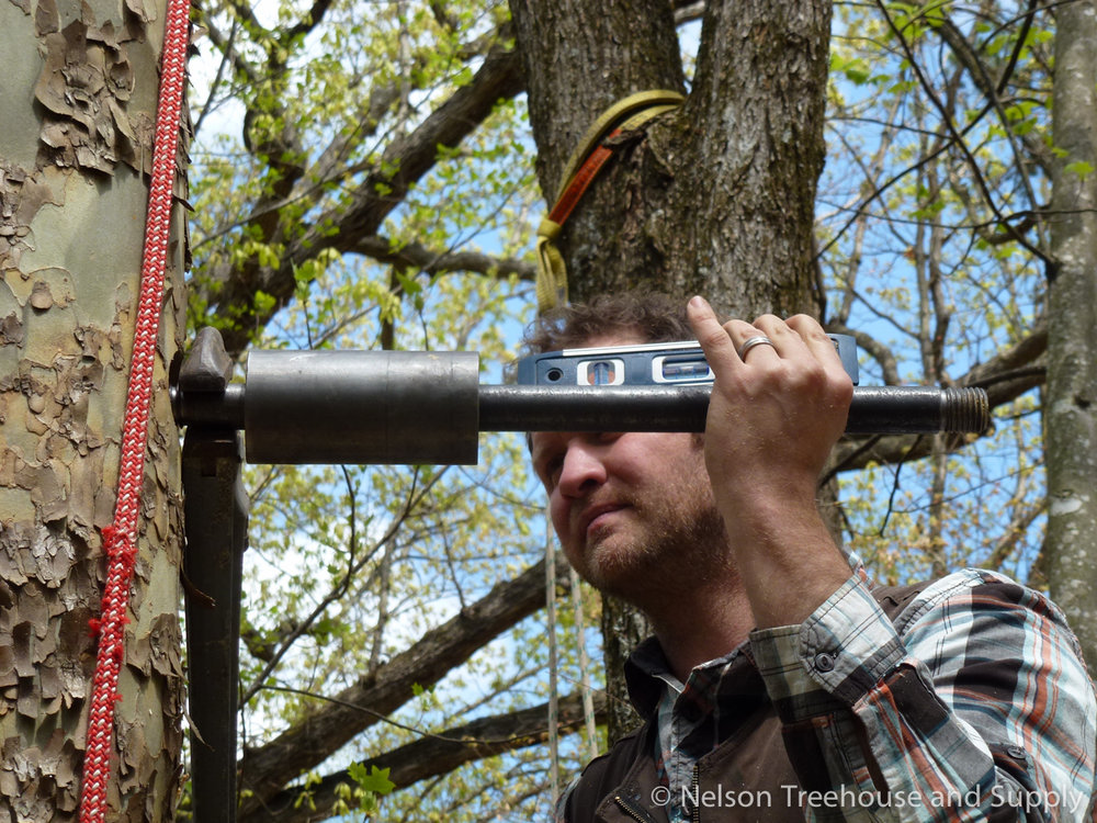 Daryl installs a tab at a treehouse workshop