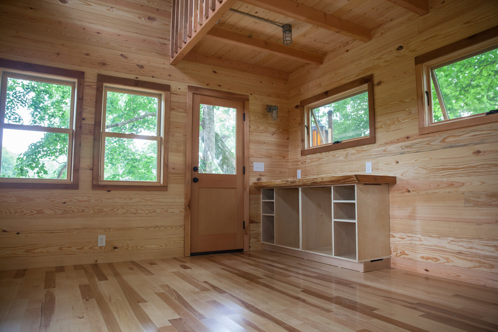 Pine paneling gives the interior a natural touch.
