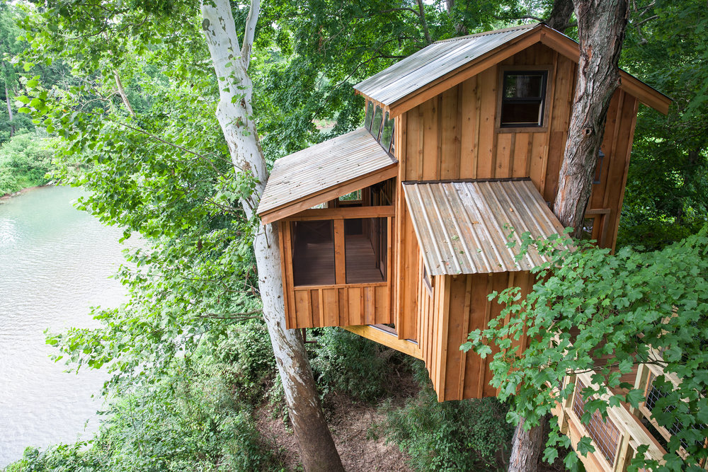 This riverbank made the perfect location for a nature-loving treehouse.
