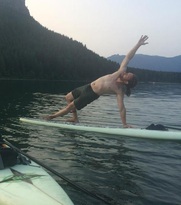 Alex doing Paddle Board yoga.