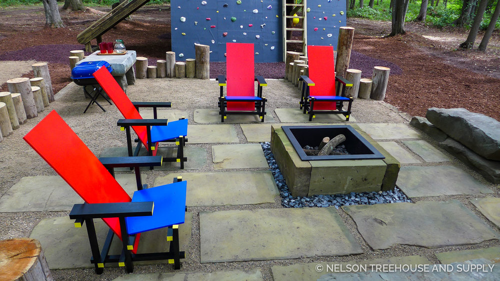 This fire pit makes the treehouse perfect for all ages - grownups will love gathering here while kids play in the trees!