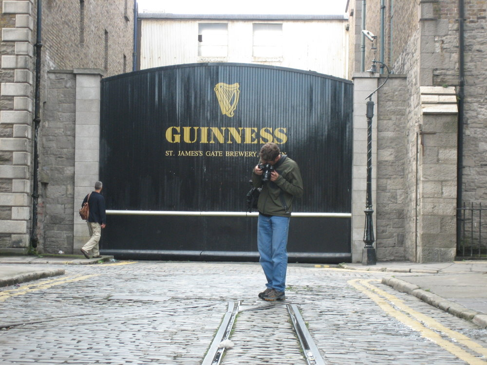 Toby photographing something fascinating in front of the guinness brewery in Dublin.