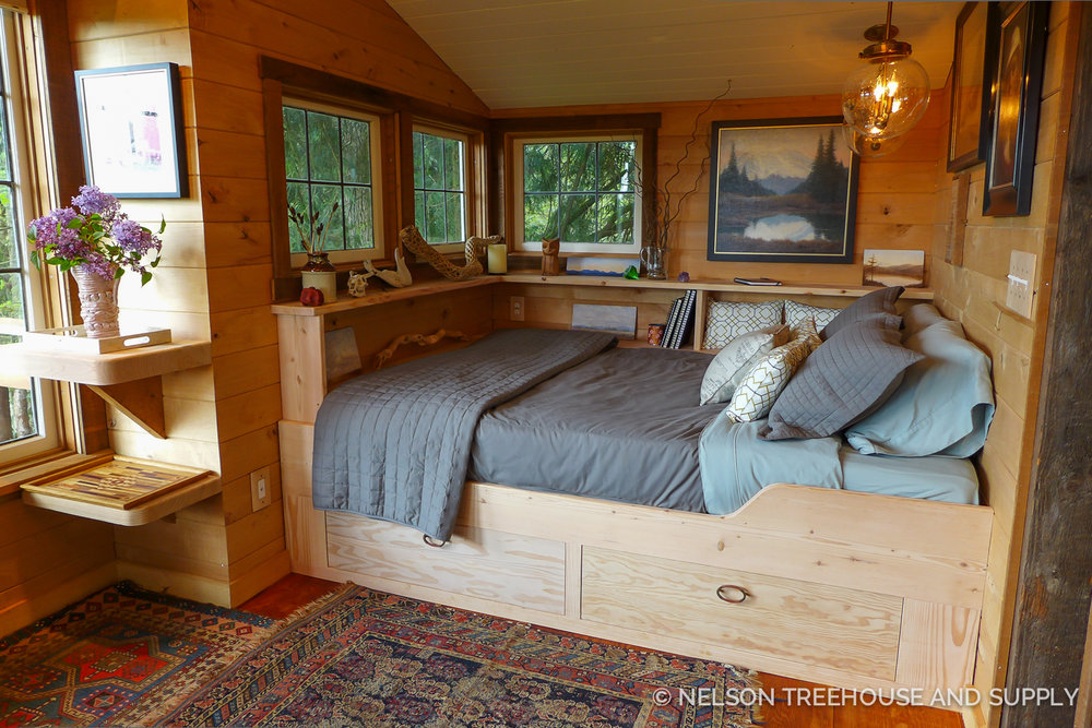A queen-sized bed fits snuggly in this nook.
