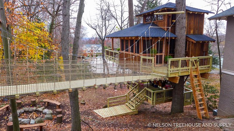 the crew had a wonderful time building this dual decked delight for mike and ranell in new jersey the couples treehouse contains every fabulous feature