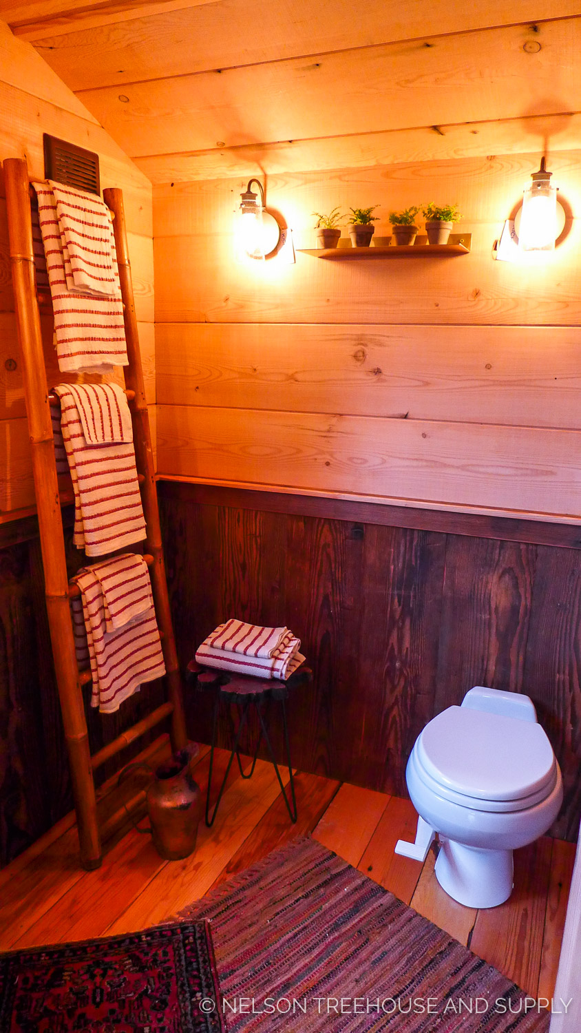 The Composting Toilet Inside The Bathroom On The Main Floor Neatly Stores  Its Composting Section In A Separate Unit Outside The Treehouse.