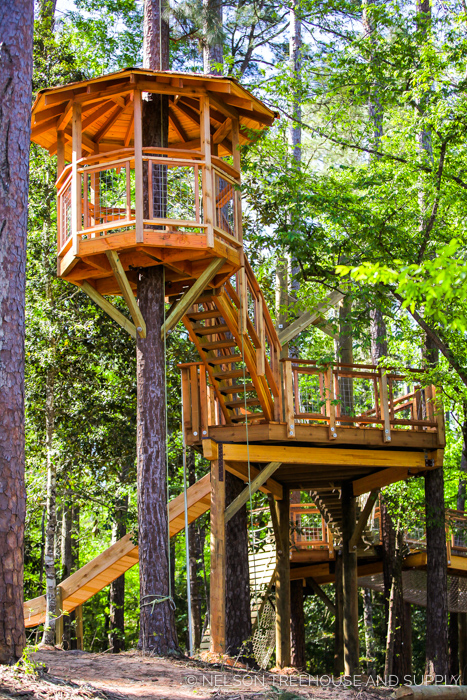 CHO YEH SUMMER CAMP TREEHOUSE    Location:  Camp Cho-Yeh, Texas  Year Built:  2016  Square Feet:  550  Elevation:  16 ft (from crow's nest) Combination tree- and wood post-supported  Seasonality:  Three-season  Fun attributes:  Climbing wall, slide, fire pole, two bridges, and 200 sq ft giant net hammock