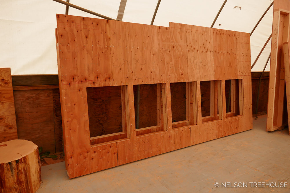 Walls of Windows wait for shipment in the Nelson Treehouse Prefab Shop