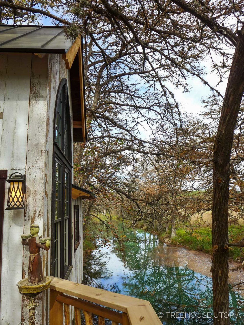 View of the river from back deck on Chapelle at Treehouse Utopia, a Texas Hill Country Retreat. Photo by Nelson Treehouse.