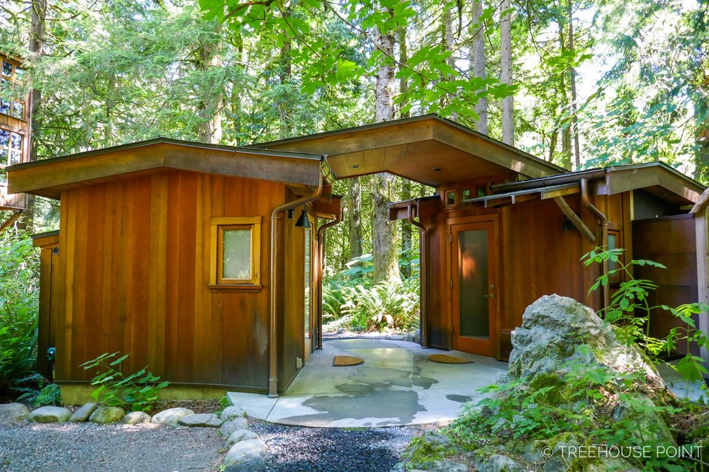 The spa-like bathhouses are lined in aromatic cedar.