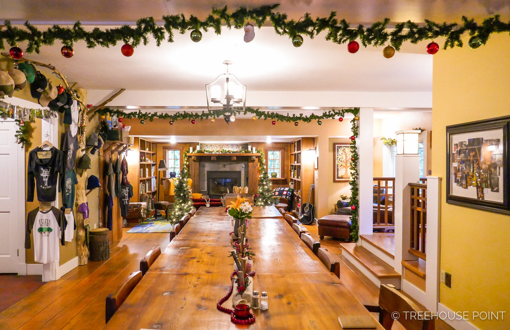 Guests gather around this table inside the Lodge for Breakfast each morning. Seasonal decorations add celebratory flair to the lodge year-round.
