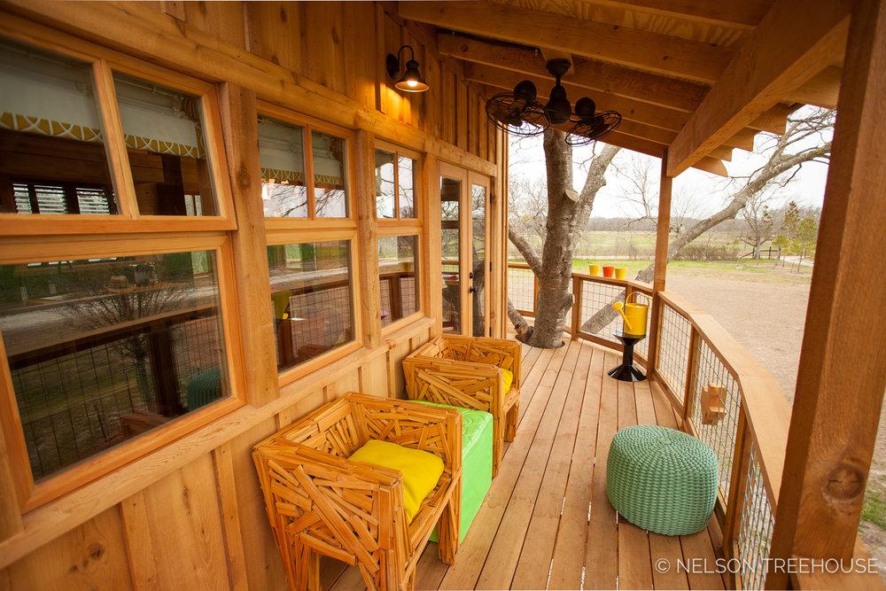 Nelson Treehouse - Twenty-Ton Texas Treehouse seating on deck