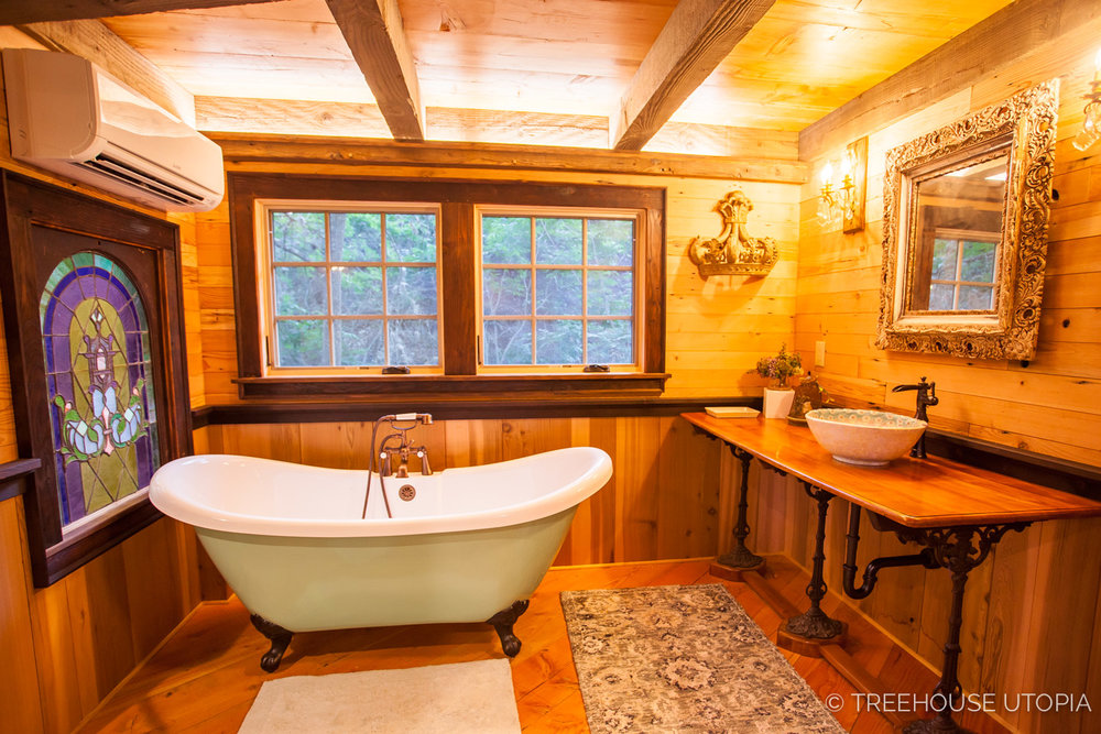 The bathroom Inside Chateau at Treehouse Utopia