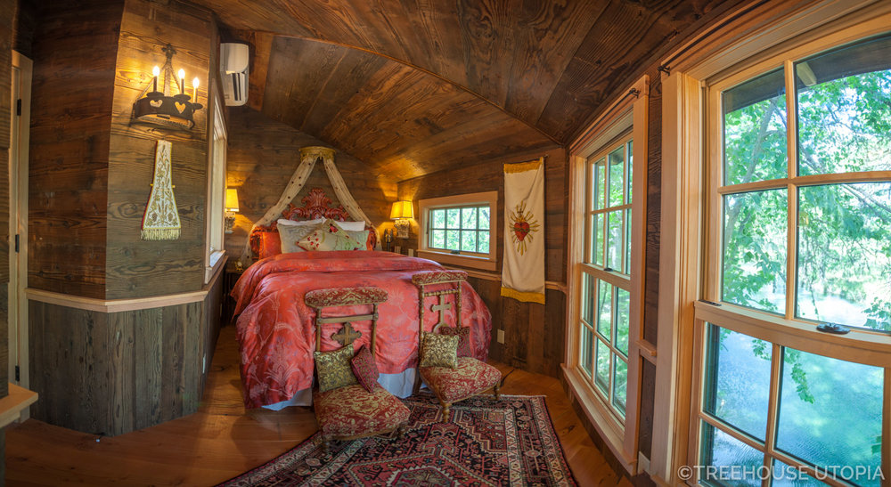 View from the bed inside Chapelle at Treehouse Utopia, a Texas Hill Country Retreat. Photo by Nelson Treehouse.