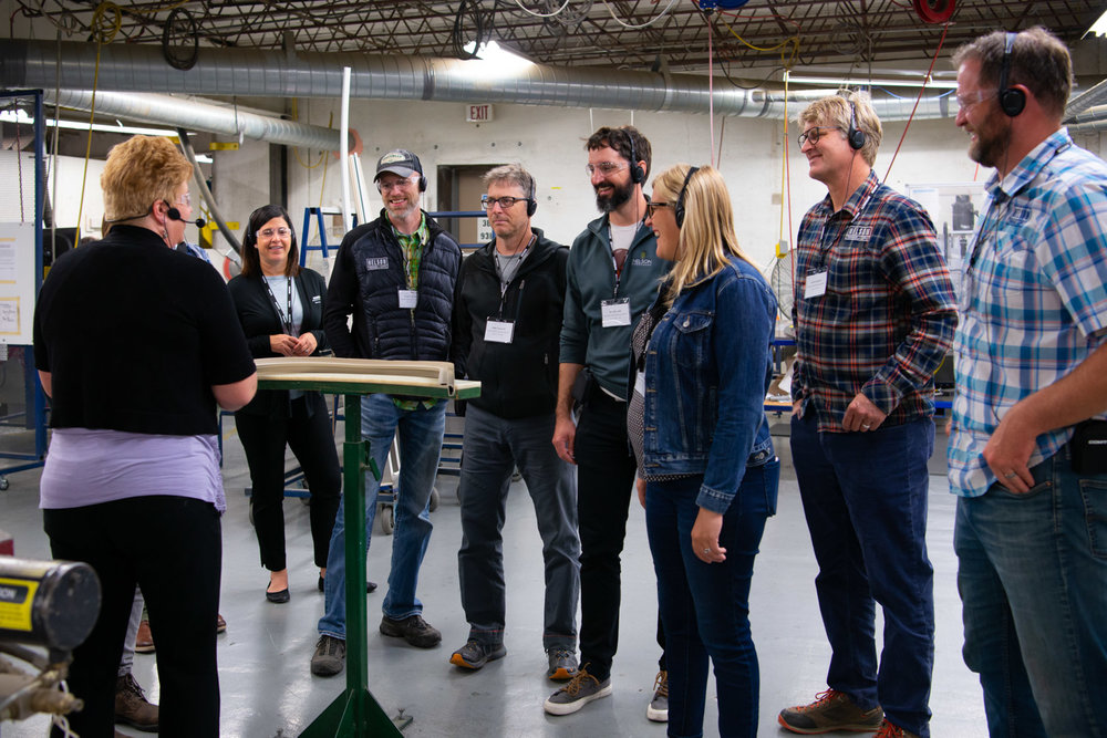 Marvin Tour guide KarLynn Erickson (Pictured On Far Left) leAdIng the Nelson Treehouse crew through the Factory. PHoto courtesy of Marvin.