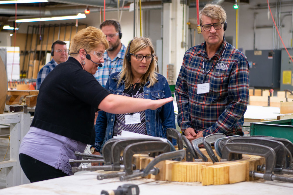 Nelson Treehouse Project Manager Daryl McDonald, Emily Nelson, and Pete Nelson learning about the Marvin Windows production process. PHoto courtesy of Marvin Windows.