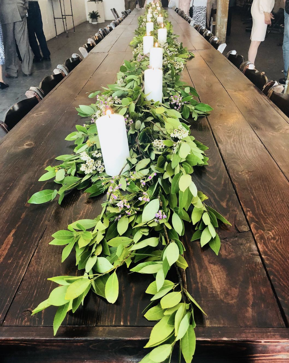 - There are few things better than lush greenery and candles to add a bit of drama to any tabletop.