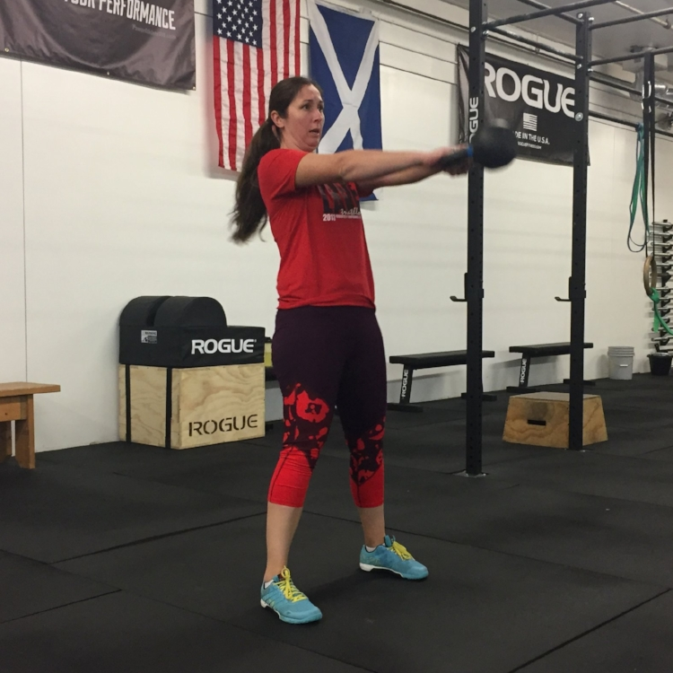 This is a picture of Stephanie Harbaugh performing kettle bell swings in a Maxmead Fitness, CrossFit, Strength & Conditioning workout or WOD in St Louis Park, MN.