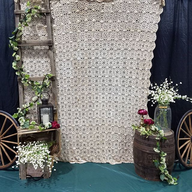 """Another great year of setting up the St. Peter's Fall Gala! This year was more modest, with the theme being """"Mansfield 150 years ago"""", in honor of the church's 150th year in existence. The table settings were reserved... lace doileys with glass hurricanes, candles, and simple floral wraps.  #corporateevents #eventdecor #eventplanner #lovingwhatido #eventdesign #fall #gala #rentalitems #customprops #pallets #backdrop"""