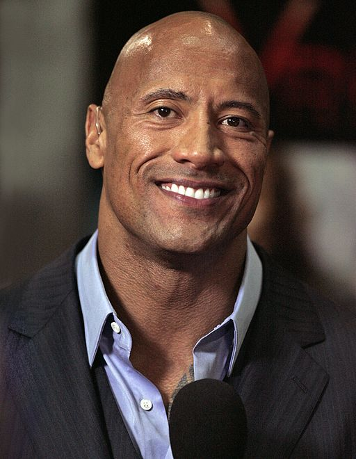 Dwayne johnson = Eva Rinaldi [CC BY-SA 2.0 (https://creativecommons.org/licenses/by-sa/2.0)], via Wikimedia Commons