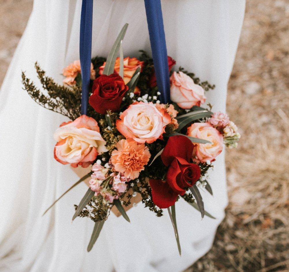 Bolsa de Amor - Abundant gathering of florals in a playful bag    $85
