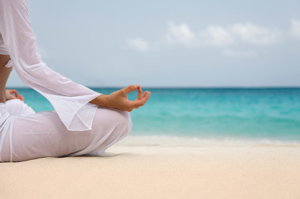 Person-seated-meditating-at-the-beach.jpg