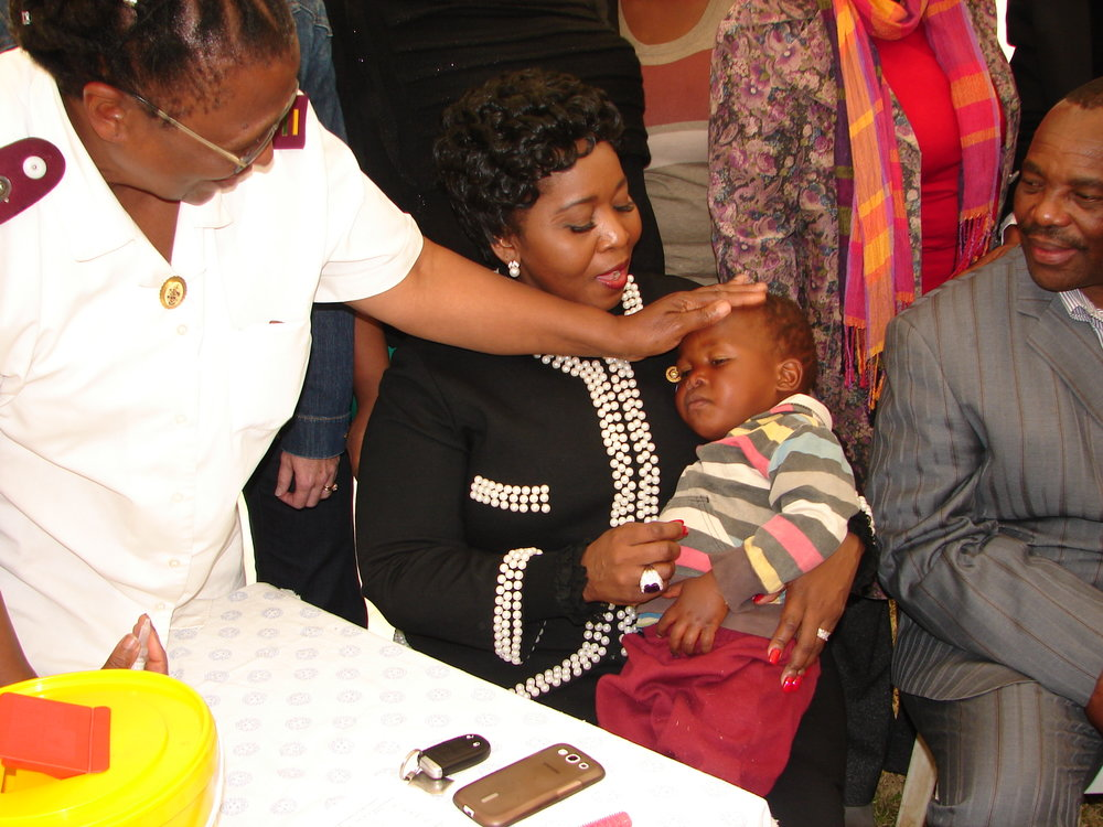 16-first-lady-madame-bongi-ngema-zuma-assists-to-administer-polio-drops-to-a-child-at-the-launch-of-the-rfhd.jpg