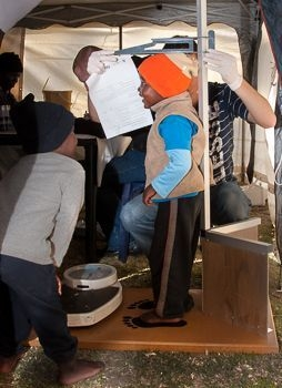 6-a-childs-height-and-growth-is-assessed-by-medical-volunteers-at-the-health-days-in-may-2013.jpg