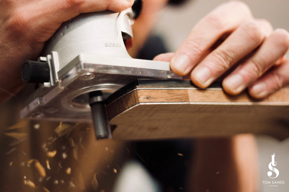 Shaping the headstock with a template and router.
