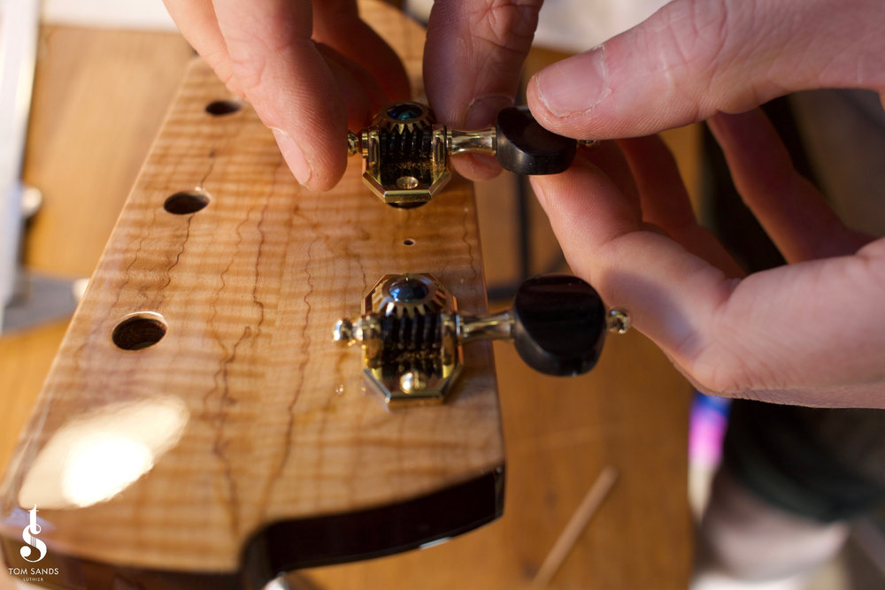 Installing the handmade Robson tuners.