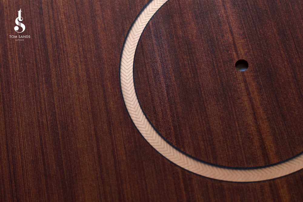 The inlayed rosette on our Signature Model.