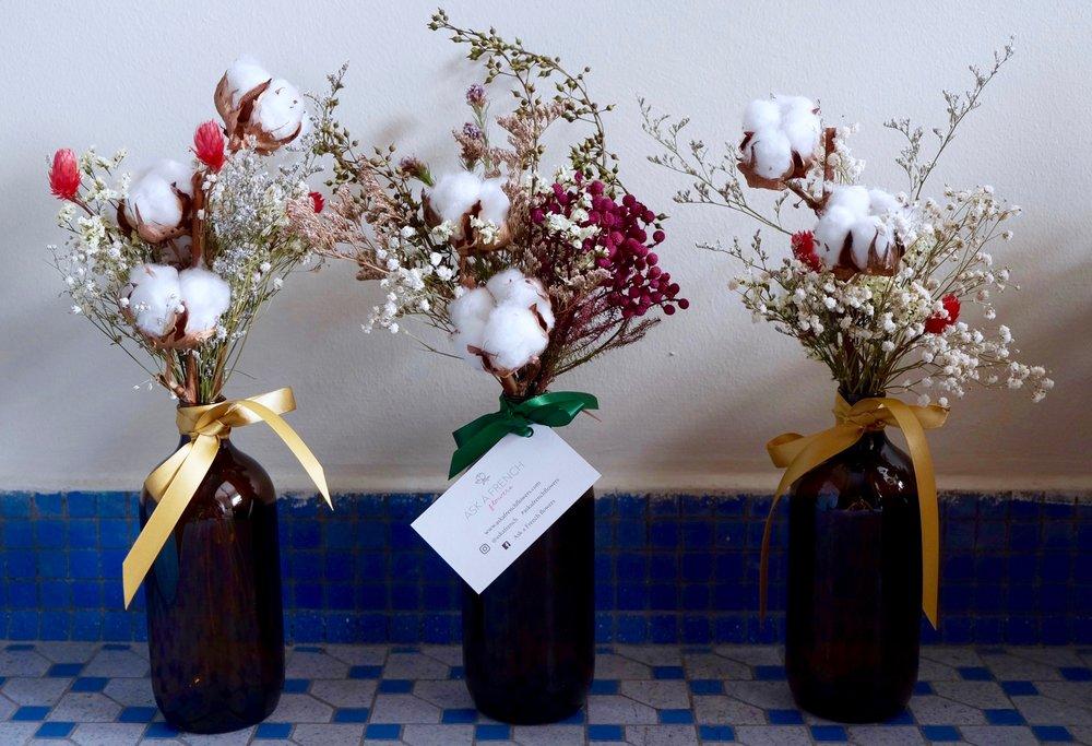 Dried cotton flowers bouquet in vintage bottle — askafrenchflowers