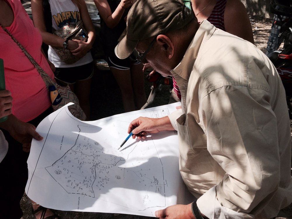 Jacobo Nunez, Director of Agua Para El Pueblo, looking at a map of the community wells. | Photo Credit: Brittany Girle from photoserve.org