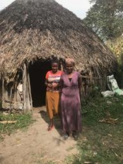 "(Fig. 1)   Tadelech Hamero, Deriba  -    "" I am so thankful for this new well; I hope my back problem will improve soon."" She finally said ''Thank you so much on behalf of my family and the community of Deriba.  God bless you!  """