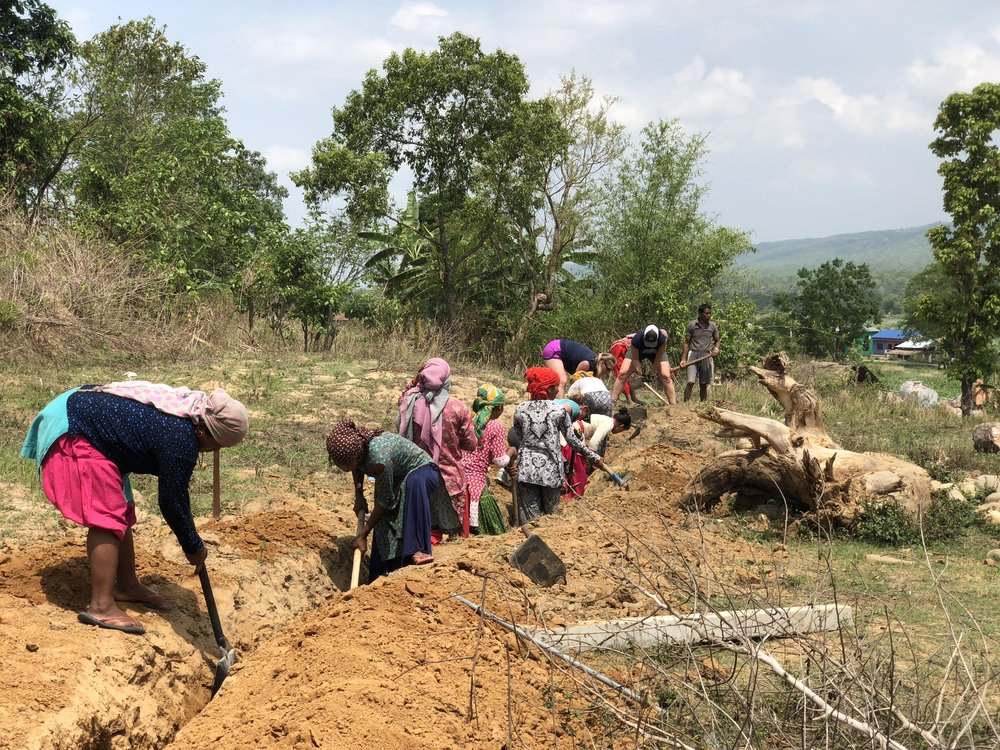 The community of woman in Riatole digging deep trenches.