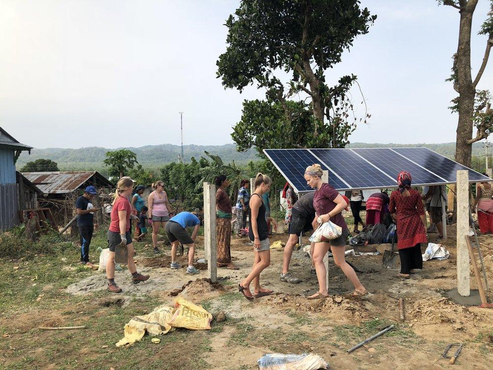 W|W Nepal team working around the New Solar powered pump.