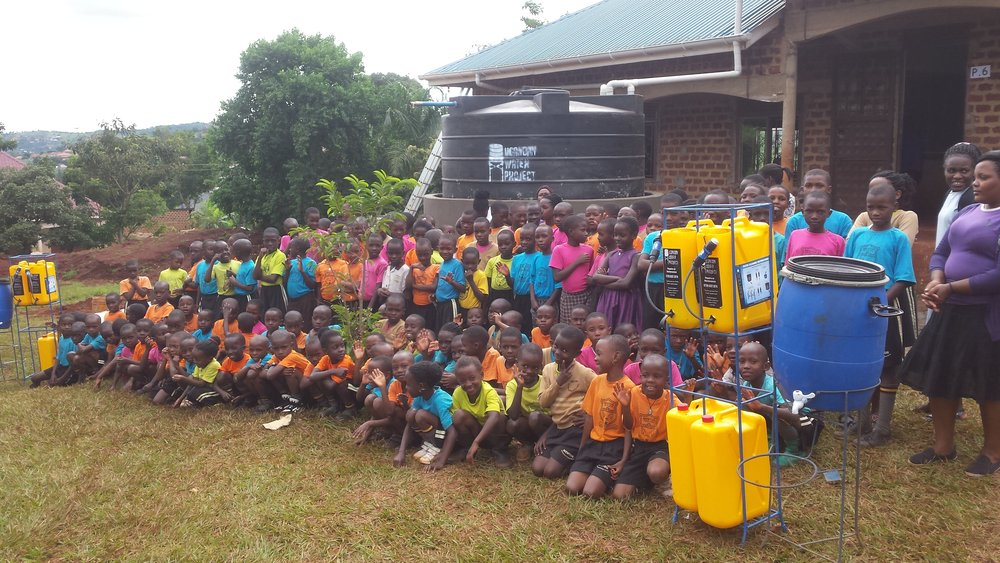 Mentor Kindergarten Students pose with their new Sawyer filters. Image courtesy of Ugandan Water Project.