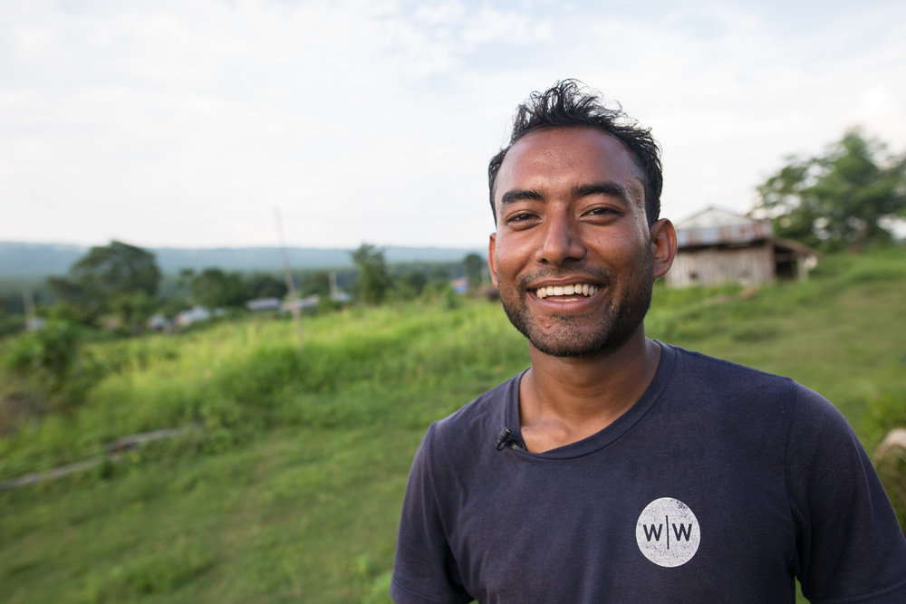 Abhishek Basnet shares his story while trekking through the Raitole community.