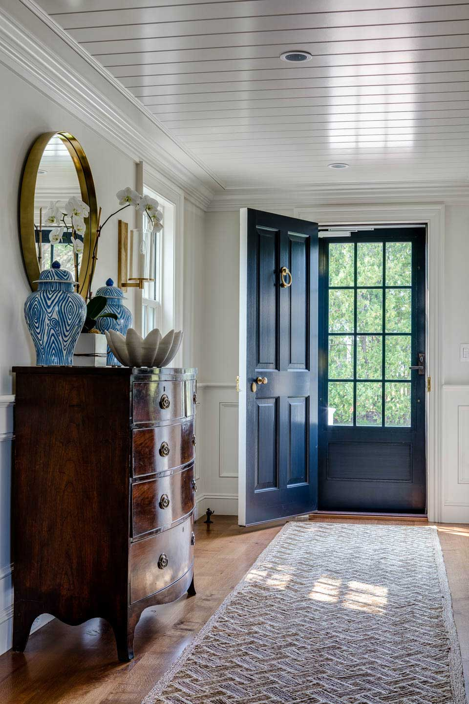 entryway, front entrance, cape cod, cape house, blue door, entry rug, runner, planked wood ceiling