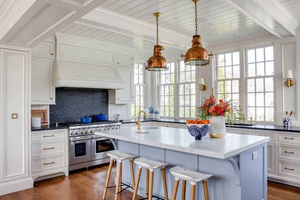 cape cod kitchen, kitchen, kitchen island, island lighting, pendant lights, stools, counter stools, island sink, white kitchen, blue island, marble counter, copper pendants