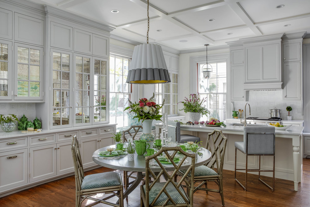 Benefit Street, Providence, Rhode Island, Kitchen, table setting, table lighting, built in cabinets, mirror front cabinets, light gray cabinetry, bamboo chairs, round dining table, counter stools
